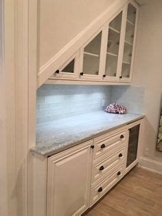sided kitchen cabinets a bar the stairs in the basement a great use of 6926