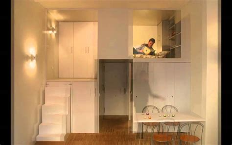 storage solutions for a small bedroom compact loft apartment in madrid displaying smart