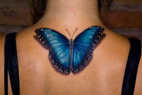 tatouage papillon bleu sur la nuque inkage