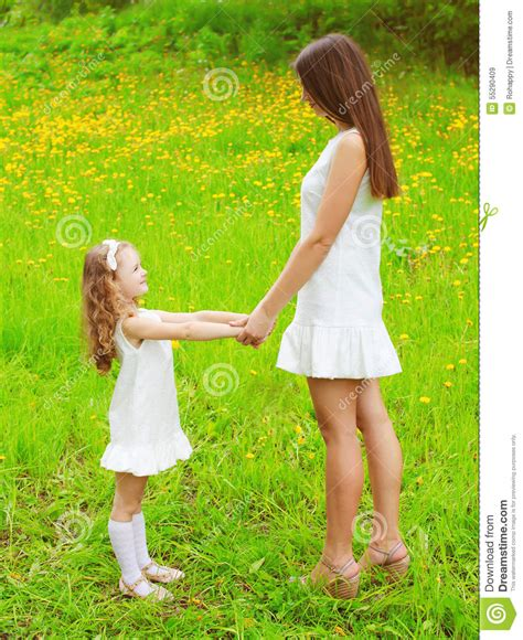 Mother And Daughter Walking And Having Fun Together In