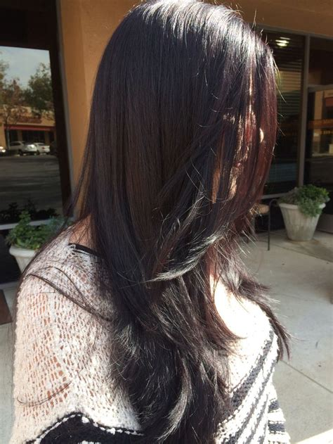 dark violet brown hair long  layers