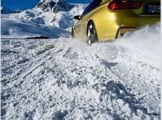 BMW M4 drifts in snow at BMW Driving Experience