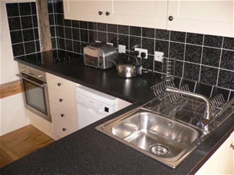 black and white wall tiles kitchen kitchen cabinet hardware spruce kitchen kitchen solvers 9290