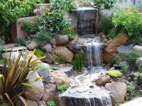 beautiful waterfalls  natural backyard  front yard ladscaping