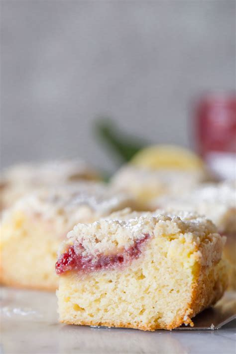 In a small bowl, combine reserved crumbs and sliced almonds. Lemon Raspberry Cream Cheese Coffee Cake - Lovely Little Kitchen