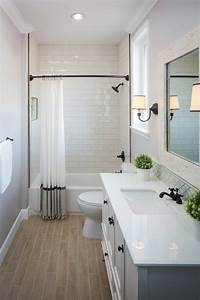 guest bathroom with wood grain tile floor subway tile in With what kind of paint to use on kitchen cabinets for school of fish metal wall art