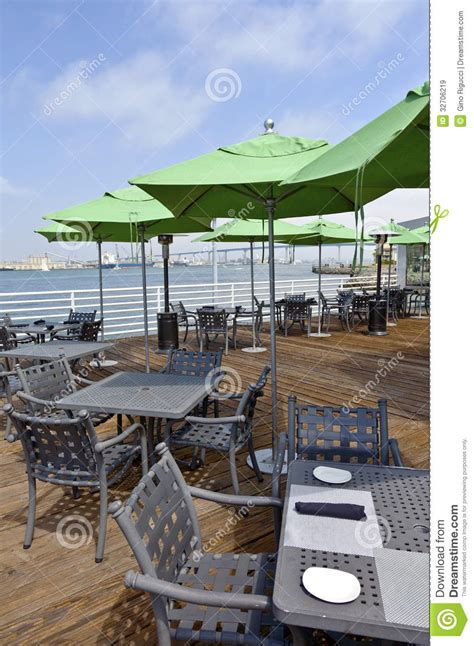 outdoor restaurant and green umbrellas royalty free stock