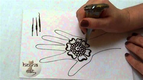 hennacatcom henna tutorials   draw  simple flower