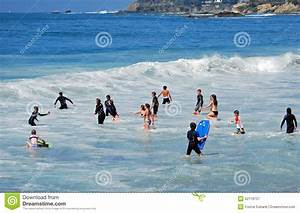 Children Playing In The Surf Of Sleepy Hollow Beach In ...