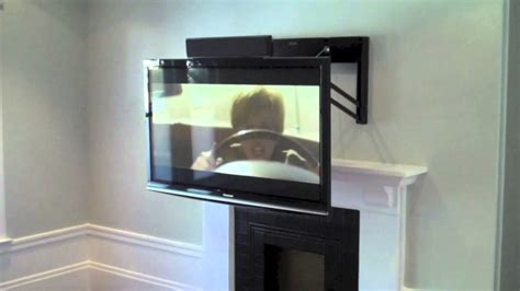 fireplace tv mount comfortvu above the fireplace tv mount
