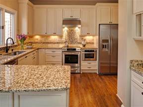 Hardwood Floor And Kitchen Cabinet Combinations by Giallo Napoli Granite Kitchen Countertops White Cabinets