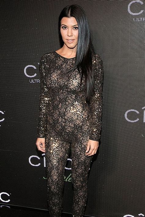 kourtney kardashian wows  sheer lacy jumpsuit parties