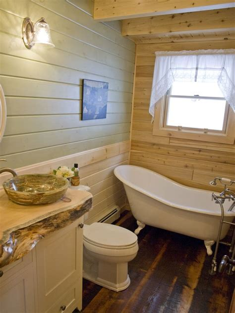 rustic log home bathroom with clawfoot tub   Katahdin Log