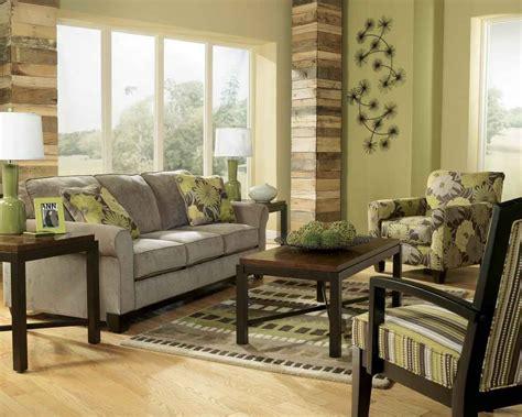 earth tone living room  green wall paint  gray sofa