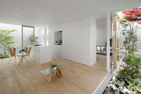green edge house features  sheltered courtyard garden