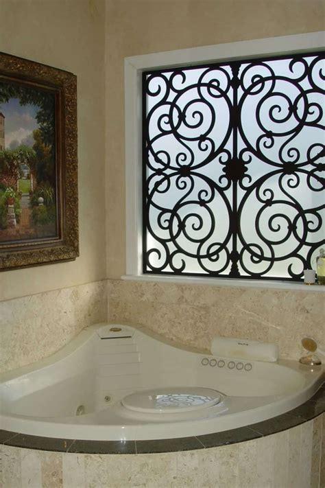 Bathroom With Corner Jacuzzi And Wrought Iron Window