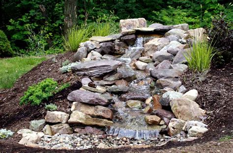 outside waterfalls pondless waterfall water features pinterest