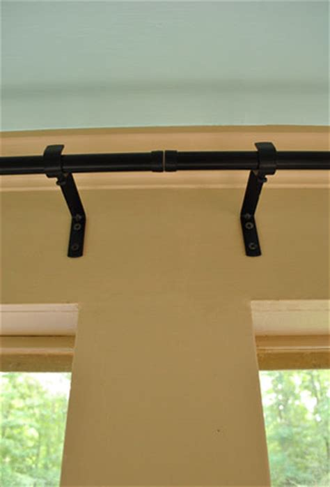 hang corner curtain rods painting  ceiling