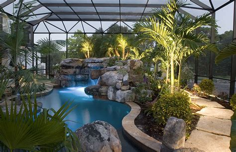landscaping around swimming pools with tropical plants in