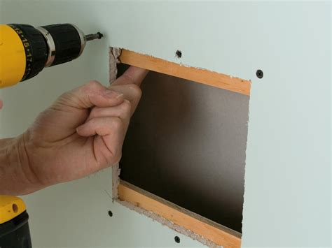 How To Repair A Hole In Drywall  Howtos Diy