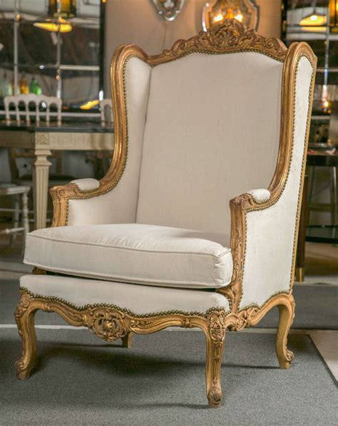 pair of louis xv style wingback bergere chairs at