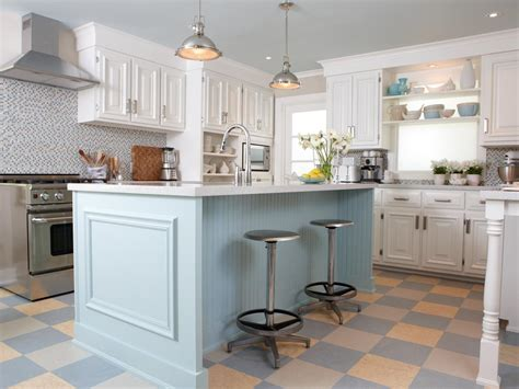 White Cottage Kitchen With Blue Island And Colorful Tile