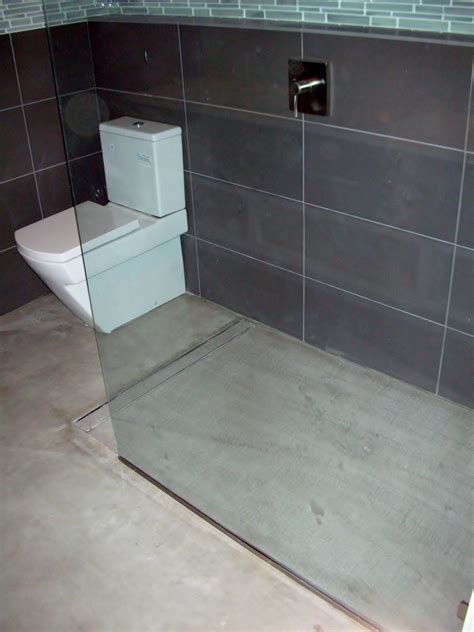 Fall In Shower Floor modern open concept bathroom featuring a concrete floor