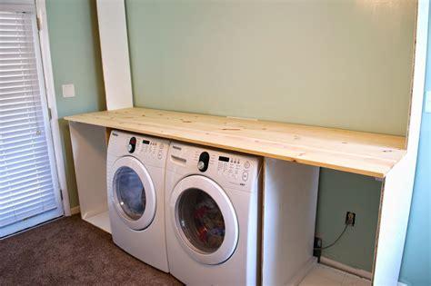 Remodelaholic  Builtin Laundry Unit With Shelving
