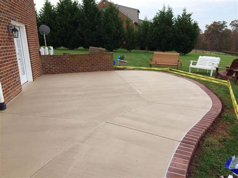 Cement Patio by Stained Concrete Patio With A Sprayed Concrete Brick