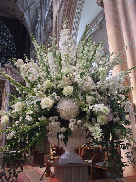 seasonal pedestal arrangement  twisted willow floristry