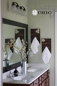 Diy towel racks for a chic bathroom update for Where to put towel bar in small bathroom