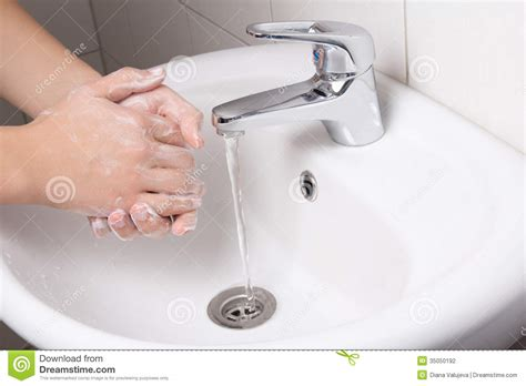 how to wash clothes in sink man washing his hands in bathroom sink stock photography