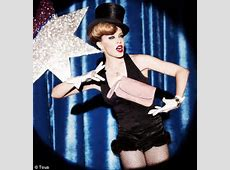 Kylie Minogue poses as a magician's assistant and gets
