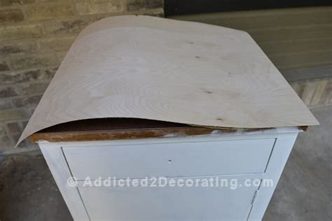 laminate covering for cabinets how to cover laminate with pretty wood veneer