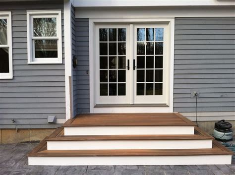 the house entrance door steps indian style steps to patio back door we recently finished the steps and deck above the decking is fiberon