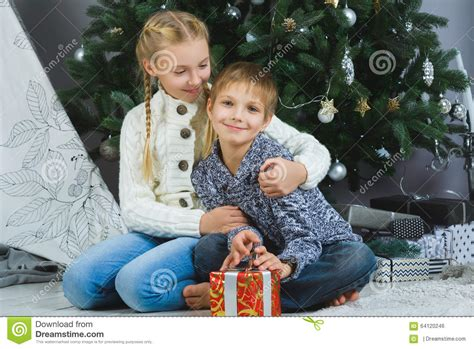 Happy Children Holding Gifts. Waiting For Stock Photo