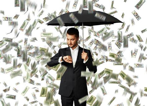 Serious Businessman With Black Umbrella Standing Under