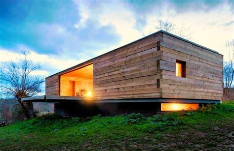 stunning  seasons house   small wooden retreat tucked   heart   spanish plains