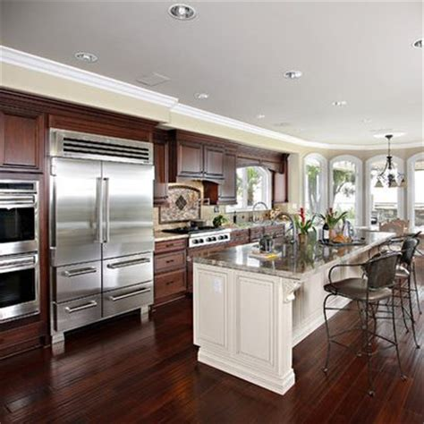 white kitchen cabinets with cherry wood floors hardwood floors kitchen white cabinets more than10 2205