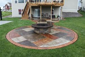 Stained concrete patio with a stone wrapped fire pit