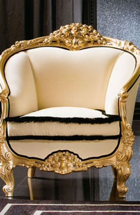 luxury upholstered arm chair gold black white meod