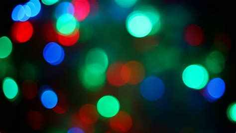 blurred colorful christmas lights  black background