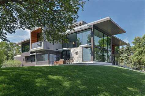 modern home features glass lake house features modern silhouette of earthy materials modern house designs