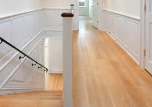 wide plank oak hardwood flooring for narrow hallway and stairs with white wall interior color