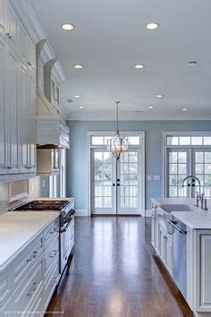 what to look for in kitchen cabinets beadboard backsplash painted blue with white cabinets 2158