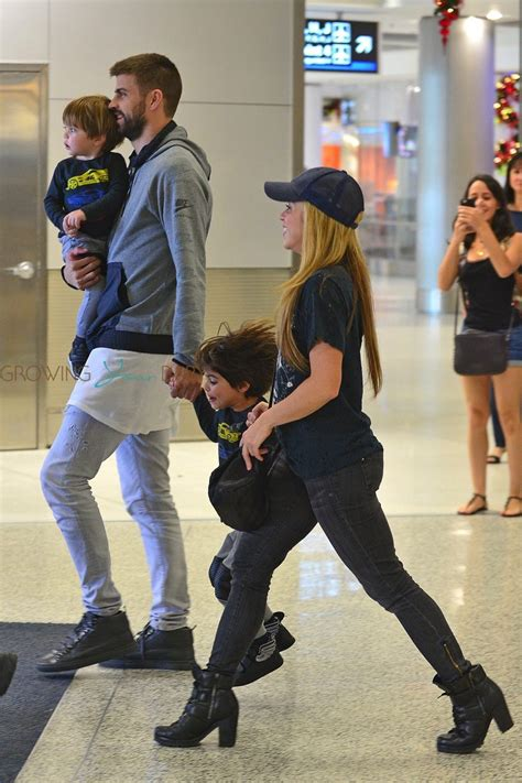 bob stroller shakira and gerard pique arrive at the miami airport with