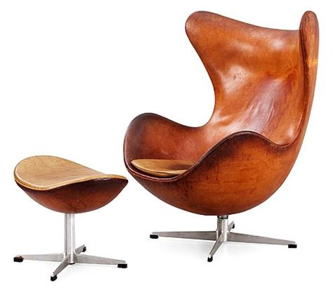 an arne jacobsen brown leather egg chair with ottoman