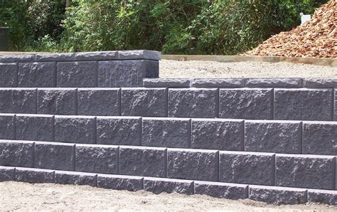 Block and stone retaining wall construction company north va. How to Build A Cinder Block Retaining Wall With Rebar ...