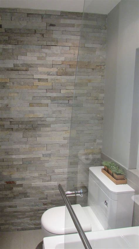 hotel style bathrooms split face tiles add texture