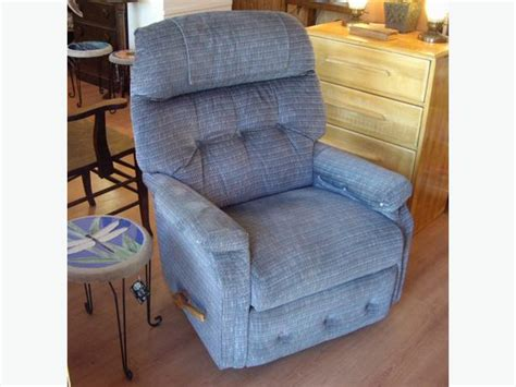 blue lazy boy brand recliner rocking chair outside